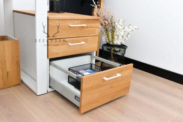 biała szafka z szufladami